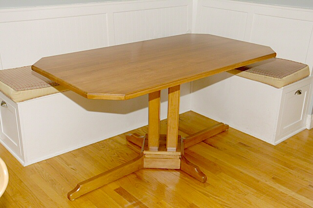 this is a pedestal kitchen table made from hard maple it is stained a light brown - Pedestal Kitchen Table